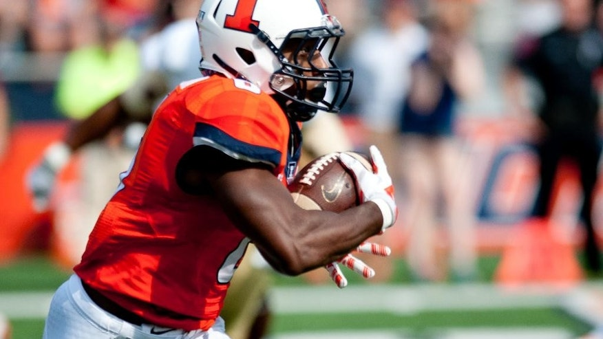 Illinois running back Josh Ferguson (6) runs the ball for an 80 yard touchdown reception on the first play of an NCAA football game against Texas State Saturday, Sept. 20, 2014, at Memorial Stadium in Champaign, Ill. (AP Photo/Bradley Leeb)