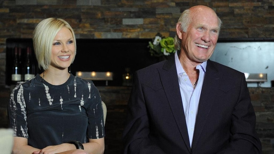 FILE - In this April 4, 2012, file photo, Rachel Bradshaw is shown with her father, former Pittsburgh Steelers quarterback Terry Bradshaw, in Nashville, Tenn. Former Nashville Titans kicker Rob Bironas died Saturday night, Sept. 20, 2014 after a car accident near his Nashville home, according to police. A missing person report filed by his new bride Rachel Bradshaw, and disturbing 911 calls have raised questions about the circumstances around Bironas' one-vehicle accident. (AP Photo/Joe Howell, File)