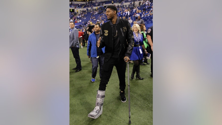 FILE - In this Sept. 15, 2014, file photo, Indiana Pacers' Paul George visits the sideline before the start of an NFL football game between the Indianapolis Colts and the Philadelphia Eagles in Indianapolis. Doctors have instructed Paul George to start putting weight on his broken right leg and have cleared him to do upper body weightlifting. Coach Frank Vogel provided the update Thursday, Sept. 25, 2014. (AP Photo/AJ Mast, File)
