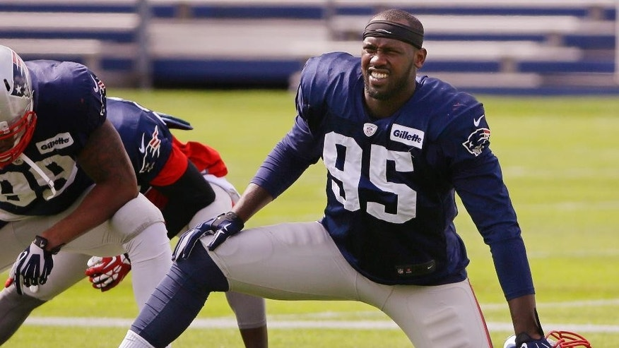 New England Patriots defensive end Chandler Jones (95) stretches before practice begins at the NFL football team's facility Wednesday, Sept. 24, 2014 in Foxborough, Mass. The Patriots will play the Kansas City Chiefs Monday night in Kansas City. (AP Photo/Stephan Savoia)