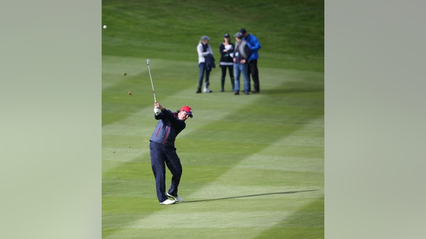 Phil Mickelson of the US plays a shot on the 7th fairway during a practice round ahead of the Ryder Cup golf tournament at Gleneagles, Scotland, Wednesday, Sept. 24, 2014. (AP Photo/Scott Heppell)