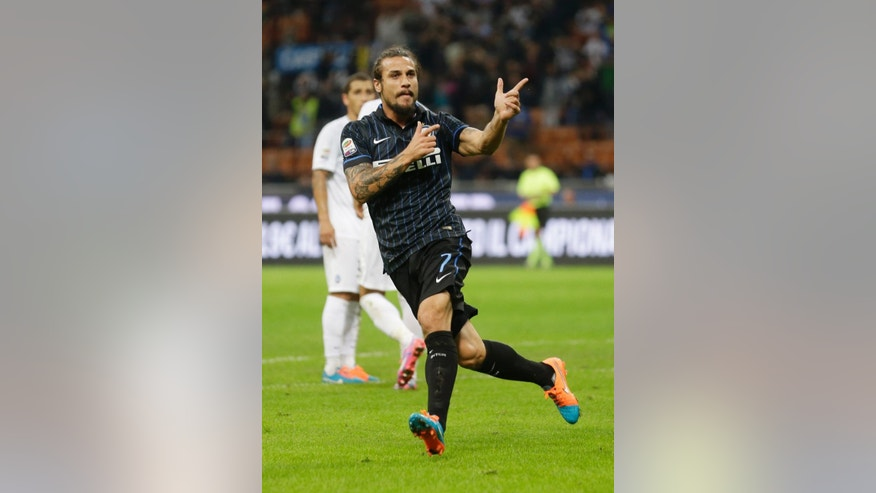 Inter Milan's Pablo Osvaldo celebrates after scoring during a Serie A soccer match between Inter Milan and Atalanta, at the San Siro stadium in Milan, Italy, Wednesday, Sept. 24 , 2014. (AP Photo/Luca Bruno)