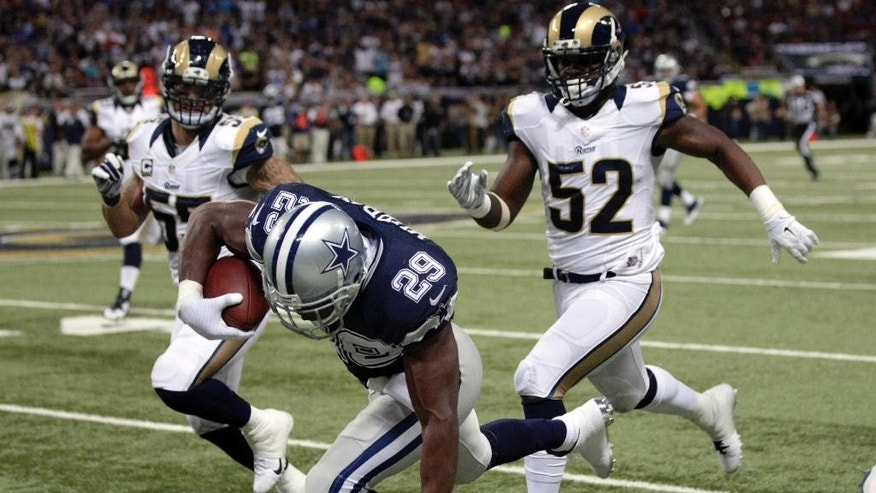 Dallas Cowboys running back DeMarco Murray (29) falls at the end of a 44-yard run as St. Louis Rams linebacker James Laurinaitis, left, and linebacker Alec Ogletree watch during the third quarter of an NFL football game Sunday, Sept. 21, 2014, in St. Louis. (AP Photo/Tom Gannam)