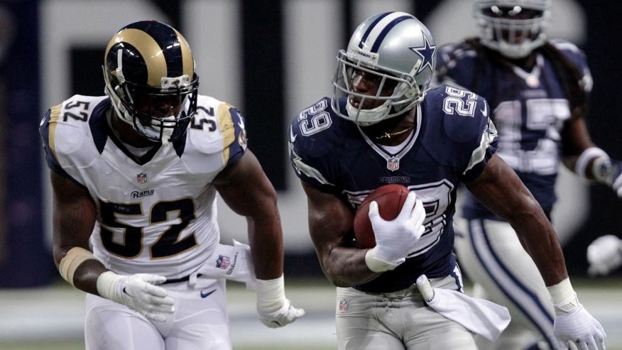 Dallas Cowboys running back DeMarco Murray, right, runs for a 44-yard gain as St. Louis Rams linebacker Alec Ogletree pursues during the third quarter of an NFL football game Sunday, Sept. 21, 2014, in St. Louis. (AP Photo/Tom Gannam)