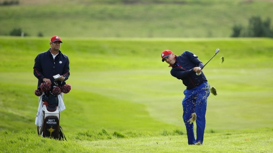 Matt Kuchar of the US is watched by his caddie Lance Bennett during a practice round ahead of the Ryder Cup golf tournament at Gleneagles, Scotland, Thursday, Sept. 25, 2014. (AP Photo/Matt Dunham)