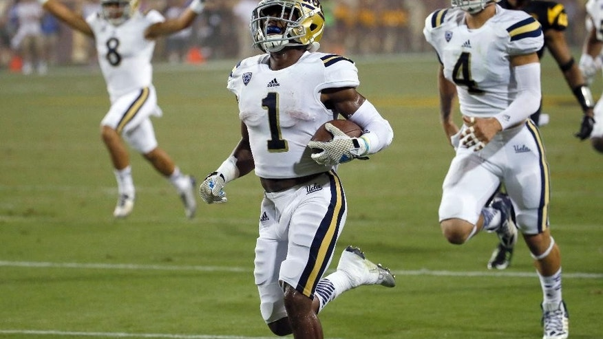 UCLA's Ishmael Adams (1) returns a kickoff 100 yards for a touchdown against Arizona State during the second half of an NCAA college football game, Thursday, Sept. 25, 2014, in Tempe, Ariz. (AP Photo/Matt York)