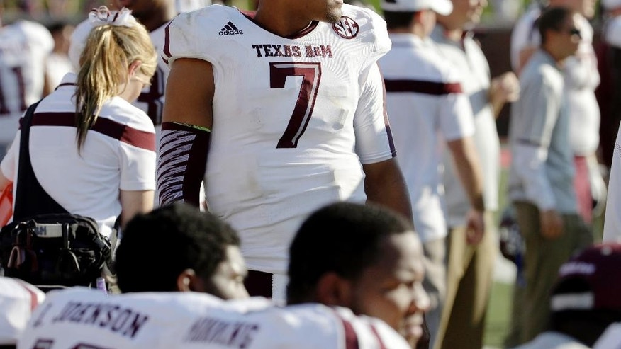Texas A&M quarterback Kenny Hill (7) stands on the sideline in the second half of an NCAA college football game against SMU,  Saturday, Sept. 20, 2014, in Dallas. Hill accounted for 322 yards of offense in just the first half of the 58-6 Aggie win.  (AP Photo/Tony Gutierrez)