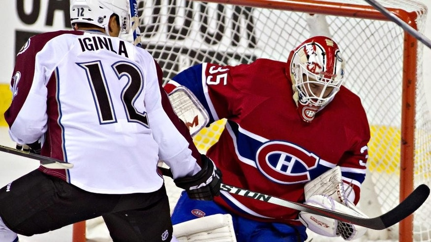 Montreal Canadiens goalie Dustin Tokarski stops the puck against Colorado Avalanche's Jarome Iginla during the first period of an NHL preseason hockey game Friday, Sept. 26, 2014, in Quebec City. (AP Photo/The Canadian Press, Clement Allard)