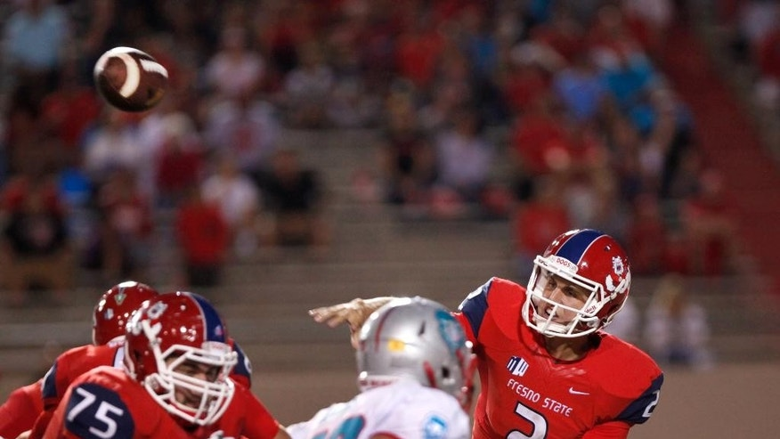 Fresno State quarterback Brian Burrell gets off a completed pass against New Mexico during the first half of an NCAA college football game Friday, Sept. 26, 2014, in Albuquerque, N.M. (AP Photo/Eric Draper)