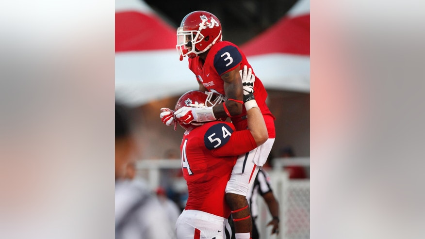 Fresno State wide receiver Josh Harper (3) celebrates his 8-yard touchdown catch with Justin Northern, against New Mexico during the first half of an NCAA college football game Friday, Sept. 26, 2014, in Albuquerque, N.M. (AP Photo/Eric Draper)