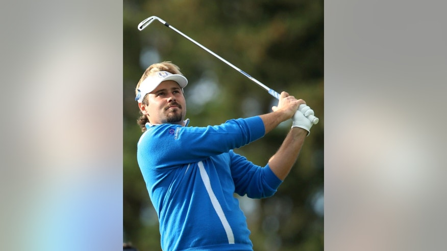 Europe's Victor Dubuisson plays a shot off the 5th tee during the foursomes match on the first day of the Ryder Cup golf tournament, at Gleneagles, Scotland, Friday, Sept. 26, 2014. (AP Photo/Peter Morrison)