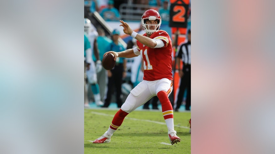 Kansas City Chiefs quarterback Alex Smith (11) looks to pass during the first half of an NFL football game against the Miami Dolphins, Sunday, Sept. 21, 2014, in Miami Gardens, Fla. (AP Photo/Lynne Sladky)