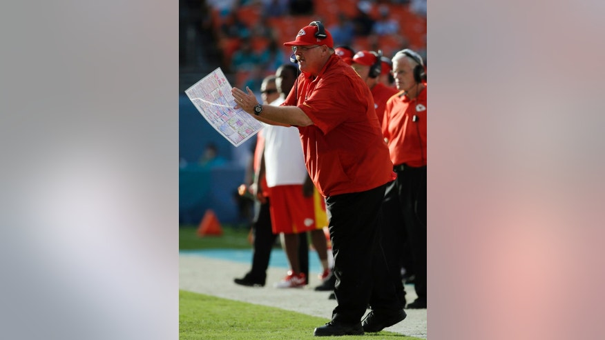 Kansas City Chiefs head coach Andy Reid yells from the sideline during the second half of an NFL football game against the Miami Dolphins, Sunday, Sept. 21, 2014, in Miami Gardens, Fla. (AP Photo/Lynne Sladky)