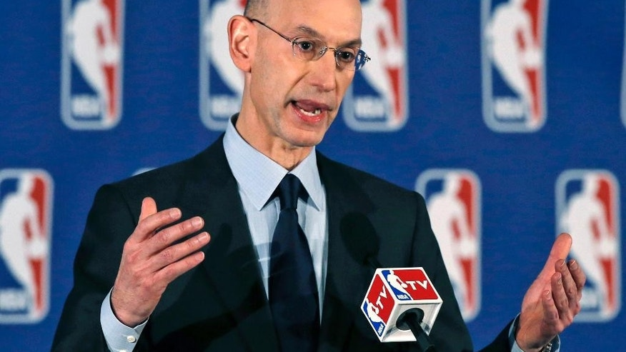 "FILE - In this April 29, 2014, file photo, NBA Commissioner Adam Silver addresses a news conference in New York. Silver says his league will ""take a fresh look"" at its domestic violence procedures following the rash of cases in the NFL.  (AP Photo/Kathy Willens, FILE)"