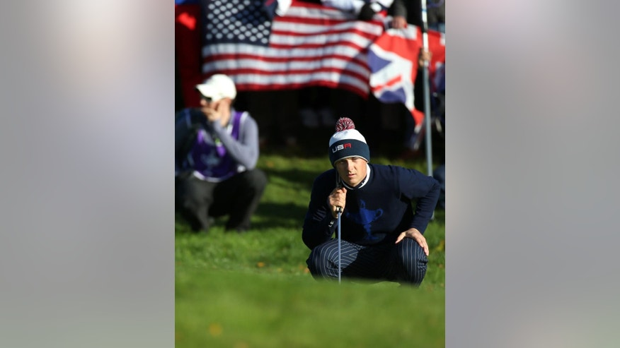 Jordan Spieth of the US lines up a putt on the 4th green during the fourball match on the first day of the Ryder Cup golf tournament, at Gleneagles, Scotland, Friday, Sept. 26, 2014. (AP Photo/Scott Heppell)
