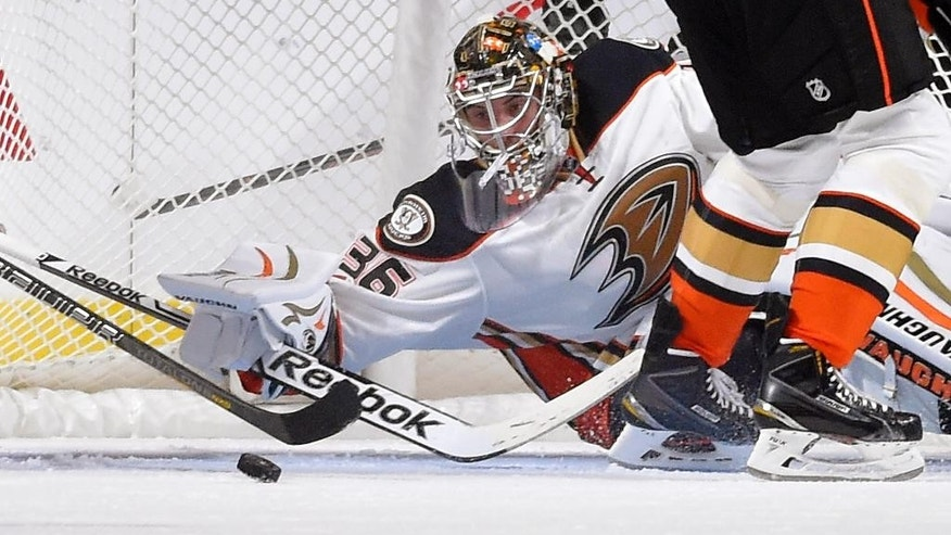 Anaheim Ducks goalie John Gibson stops a shot during the first period of a preseason NHL hockey game against the Los Angeles Kings, Thursday, Sept. 25, 2014, in Los Angeles. (AP Photo/Mark J. Terrill)