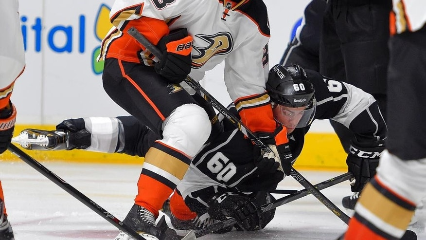 Anaheim Ducks center William Karlsson, left, of Sweden, and Los Angeles Kings center Jordan Weal vie for the puck during the second period of a preseason NHL hockey game, Thursday, Sept. 25, 2014, in Los Angeles. (AP Photo/Mark J. Terrill)