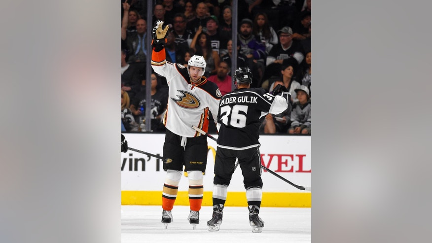 Anaheim Ducks left wing Dany Heatley, left, celebrates after scoring as Los Angeles Kings left wing David Van der Gulik watches during the second period of a preseason NHL hockey game, Thursday, Sept. 25, 2014, in Los Angeles. (AP Photo/Mark J. Terrill)
