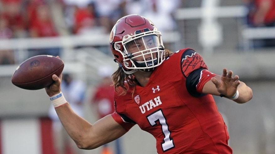 FILE - In this Aug. 28, 2014, file photo, Utah's Travis Wilson (7) throws the ball in the second quarter during an NCAA college football game against Idaho State in Salt Lake City. Wilson has thrown for 618 yards and has seven touchdowns with no interceptions as he leads the undefeated Utes (3-0) into Saturday's game against Washington State. (AP Photo/Rick Bowmer, File)