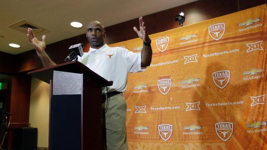 Texas NCAA college head football coach Charlie Strong talks to the media during his weekly news conference, Monday, Sept. 22, 2014, in Austin, Texas. (AP Photo/Eric Gay)