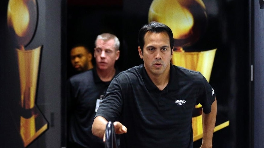 Miami Heat head coach Erik Spoelstra walks into the interview room during NBA basketball media day, Friday, Sept. 26, 2014, in Miami. (AP Photo/Lynne Sladky)