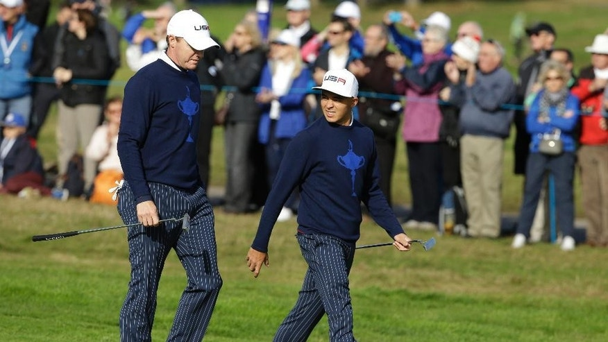 Jimmy Walker, left, and Rickie Fowler, right, of the US walk along the 10th fairway during the fourball match on the first day of the Ryder Cup golf tournament, at Gleneagles, Scotland, Friday, Sept. 26, 2014. (AP Photo/Matt Dunham)