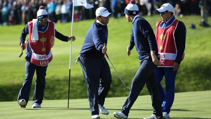 Patrick Reed, center left, and Jordan Spieth, 2nd right, of the US celebrate on the 11th green during the fourball match on the first day of the Ryder Cup golf tournament, at Gleneagles, Scotland, Friday, Sept. 26, 2014. (AP Photo/Scott Heppell)