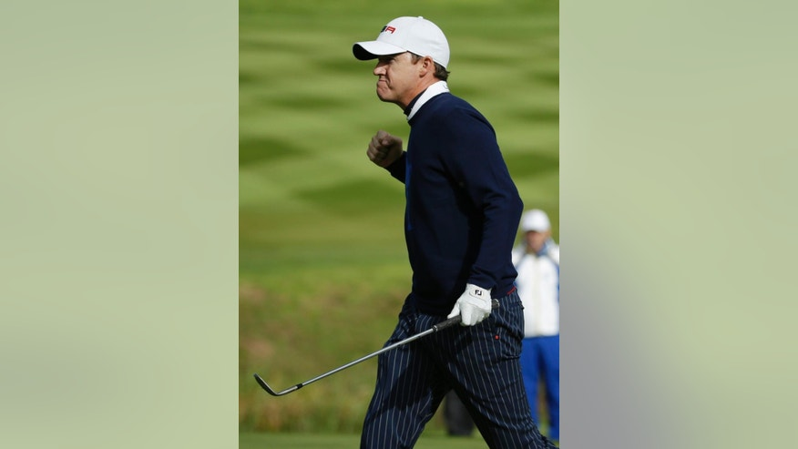 Jimmy Walker of the US celebrates on the 16th green during the fourball match on the first day of the Ryder Cup golf tournament, at Gleneagles, Scotland, Friday, Sept. 26, 2014. (AP Photo/Matt Dunham)