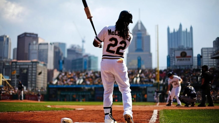 FILE - In this Sept. 21, 2014, file photo, Pittsburgh Pirates' Andrew McCutchen (22) warms up in the on deck circle during the eighth inning  of a baseball game against the Milwaukee Brewers in Pittsburgh. The Pirates are heading to the playoffs yet again led by McCutchen an intense, charismatic and imminently talented player who has become the biggest star in a city where Sidney Crosby, Ben Roethlisberger and Troy Polamalu also work. (AP Photo/Gene J. Puskar, File)