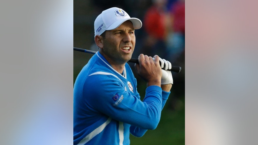 Europe's Sergio Garcia watches his shot out of the rough on the 18th hole during the foursomes match on the first day of the Ryder Cup golf tournament at Gleneagles, Scotland, Friday, Sept. 26, 2014. (AP Photo/Matt Dunham)