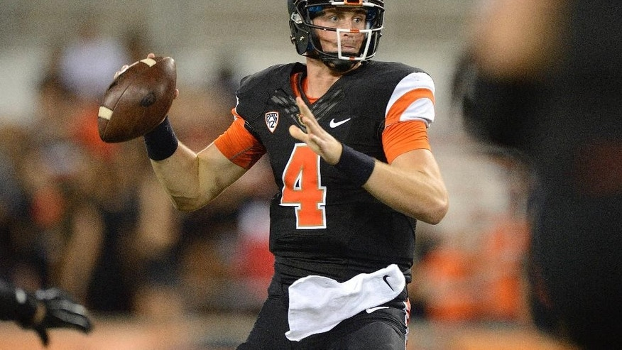 Oregon State quarterback Sean Mannion (4) passes against San Diego State during the fourth quarter of an NCAA college football game in Corvallis, Ore., Saturday, Sept. 20, 2014. (AP Photo/Troy Wayrynen)