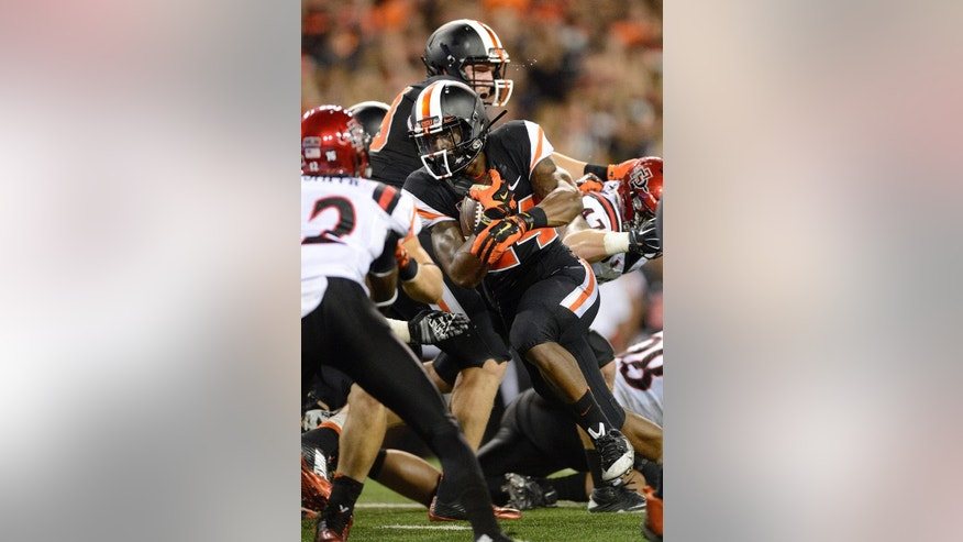 Oregon State Storm Woods (24) rushes for a touchdown against San Diego State during the third quarter of an NCAA college football game in Corvallis, Ore., Saturday, Sept. 20, 2014. (AP Photo/Troy Wayrynen)