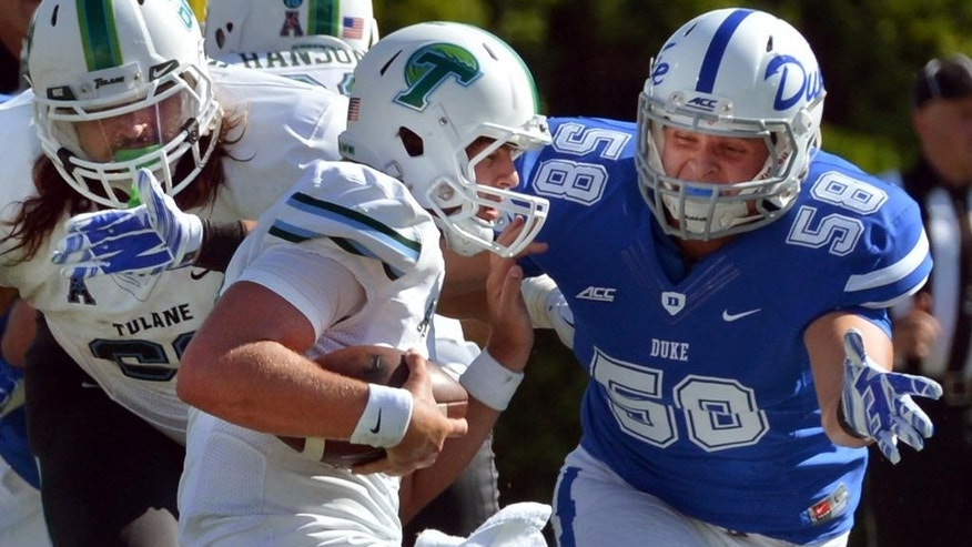 Duke defensive end Michael Mann (58) goes in to sack Tulane quarterback Tanner Lee (12) in the fourth quarter of play, Saturday, Sept. 20, 2014 at Wallace Wade Stadium in Durham, N.C.. Duke defeated Tulane 47-13 to remain perfect at 4-0. (AP Photo/The News & Observer, Chuck Liddy) MANDATORY CREDIT