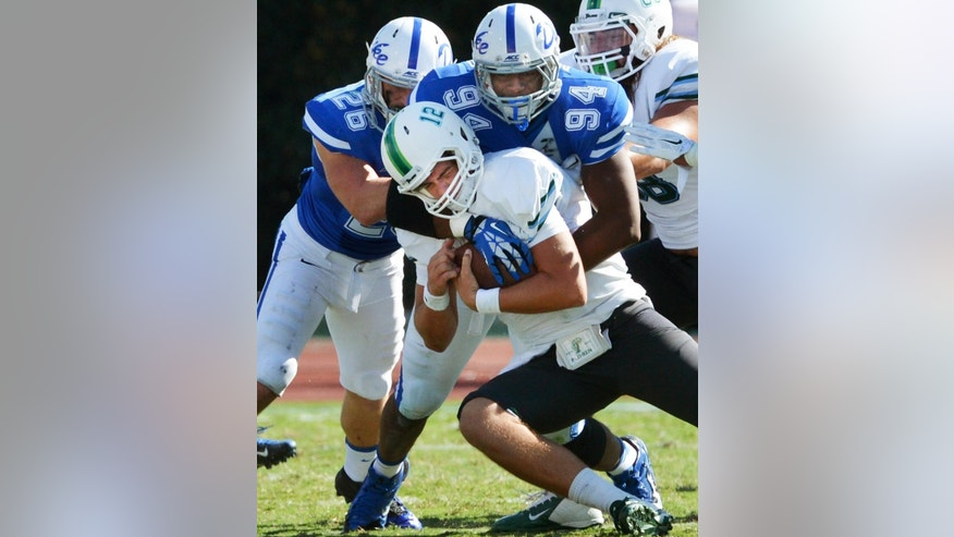 Duke defensive end Jordan DeWalt-Ondijo (94) sacks Tulane quarterback Tanner Lee (12) in the fourth quarter, Saturday, Sept. 20, 2014 at Wallace Wade Stadium in Durham, N.C.. Duke defeated Tulane 47-13 to remain perfect at 4-0. (AP Photo/The News & Observer, Chuck Liddy) MANDATORY CREDIT