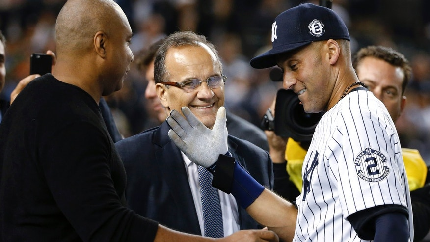 Jeter is greeted by Bernie Williams and Joe Torre at the end of the game on Thursday, Sept. 25, 2014, in New York.