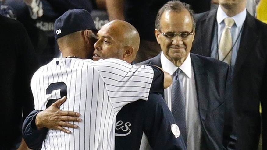 Jeter hugs Mariano Rivera after playing in his last home baseball game at Yankee Stadium, Thursday, Sept. 25, 2014, in New York.