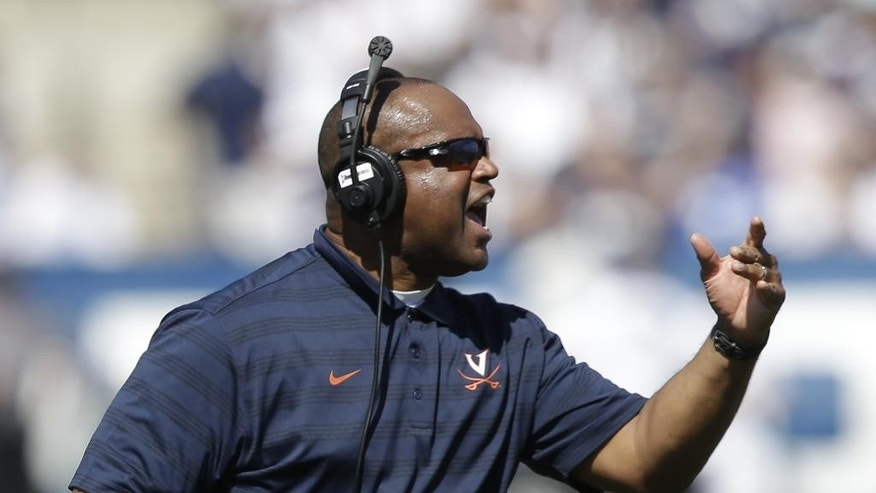 Virginia head coach Mike London reacts to a call in the second quarter during an NCAA college football game against Brigham Young, Saturday, Sept. 20, 2014, in Provo, Utah. (AP Photo/Rick Bowmer)