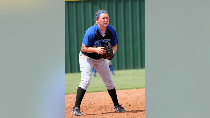 This undated photo released by North Central Texas College shows softball player Katelynn Woodlee in   Gainesville, Texas. Woodlee, 18, was one of four teammates killed when an 18-wheel truck veered into oncoming traffic on a major interstate highway and crashed into the side of their team bus Friday night, Sept. 26, 2014,  near Davis, Okla. (AP Photo/North Central Texas College)