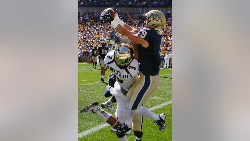 Pittsburgh defensive back Ray Vinopal (9) intercepts a pass in the end zone intended for Akron wide receiver L.T. Smith (3) in the first quarter of the NCAA college football game on Saturday, Sept. 27, 2014 in Pittsburgh. (AP Photo/Keith Srakocic)