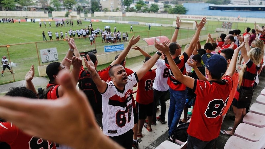 Fans of Flamengo Futebol Americano team wave their hands during aTouchdown tournament match at Portuguesa stadium in Rio de Janeiro, Brazil, Saturday, Sept. 27, 2014. American football, once the sport Brazilians couldn't understand, is quickly gaining space in the land of soccer, attracting a growing number of fans and participants. (AP Photo/Leo Correa)