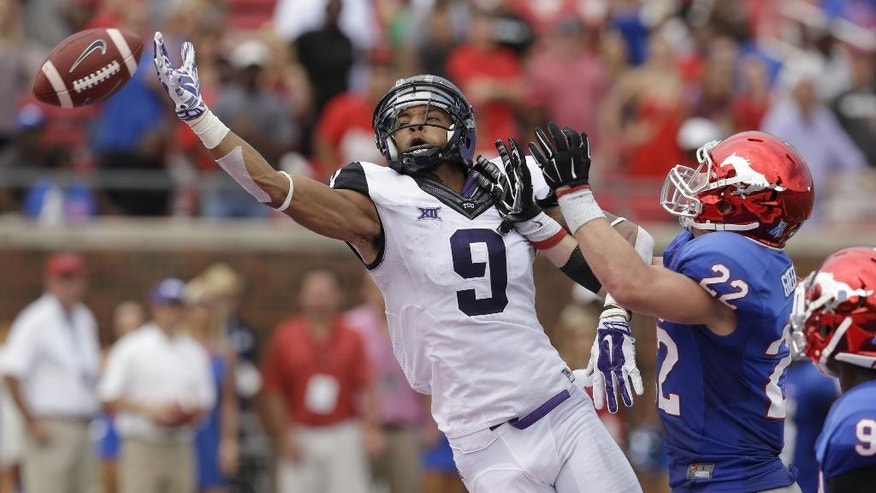 TCU wide receiver Josh Doctson (9) reaches for a pass against SMU defensive back Hayden Greenbauer (22) during the first half of an NCAA college football game Saturday, Sept. 27, 2014, in Dallas. (AP Photo/LM Otero)