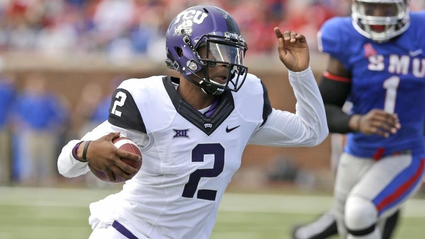 TCU quarterback Trevone Boykin (2) evades SMU linebacker Jonathan Yenga (1) on his way to running for a 27-yard touchdown during the first half of an NCAA college football game Saturday, Sept. 27, 2014, in Dallas. (AP Photo/LM Otero)