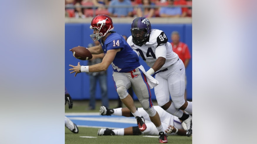 SMU quarterback Garrett Krstich (14) is sacked by TCU defensive end Josh Carraway (94) during the first half of an NCAA college football game Saturday, Sept. 27, 2014, in Dallas. (AP Photo/LM Otero)
