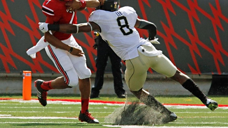 Louisville quarterback Reggie Bonnafon (7) attempts to break a tackle by Wake Forest linebacker Marquel Lee (8) on a run in the first half of their NCAA college football game in Louisville, Ky., Saturday, Sept. 27, 2014. (AP Photo/Garry Jones)