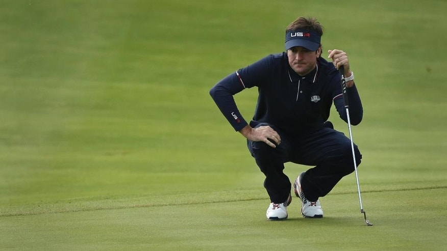 Bubba Watson of the US lines up a putt on the 5th green during the fourball match on the second day of the Ryder Cup golf tournament, at Gleneagles, Scotland, Saturday, Sept. 27, 2014. (AP Photo/Peter Morrison)