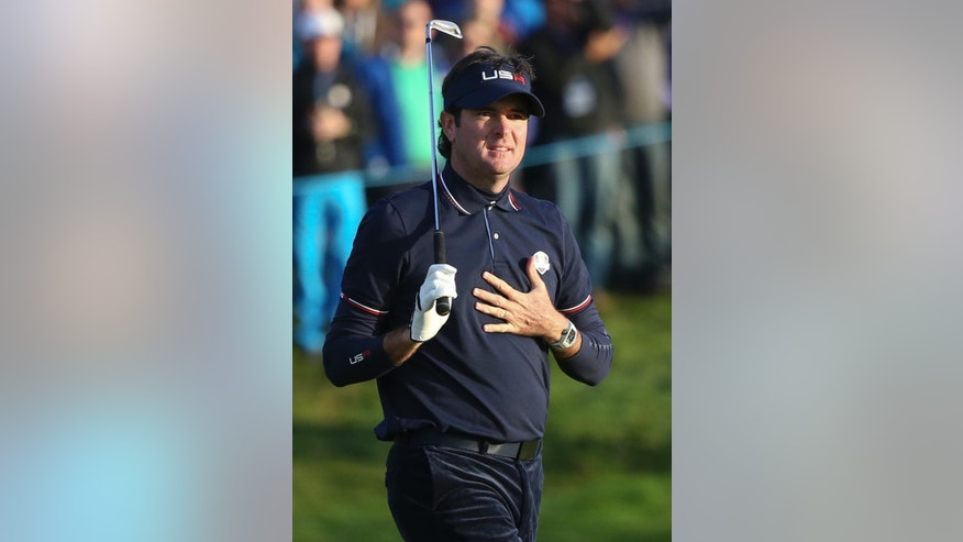 Bubba Watson of the US watches his shot on the 2nd fairway during the fourball match on the second day of the Ryder Cup golf tournament, at Gleneagles, Scotland, Saturday, Sept. 27, 2014. (AP Photo/Peter Morrison)