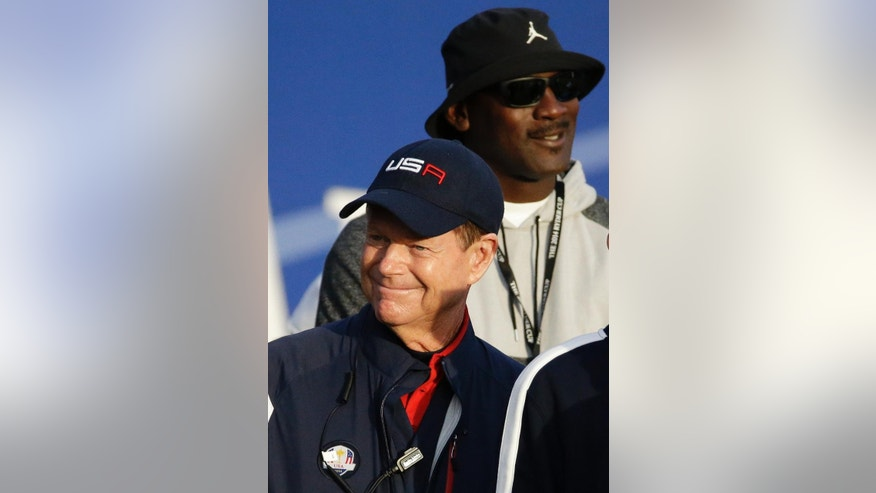 US team captain Tom Watson and basketball legend Michael Jordan stand on the 1st tee box during the fourball match on the second day of the Ryder Cup golf tournament, at Gleneagles, Scotland, Saturday, Sept. 27, 2014. (AP Photo/Matt Dunham)