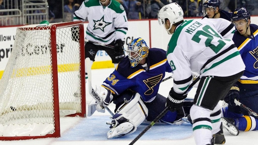 St. Louis Blues goalie Jake Allen (34) looks back as a shot by Dallas Stars defenseman Derek Meech (28) hits the back of the net to score in the second period of a preseason NHL hockey game at the Sprint Center in Kansas City, Mo., Saturday, Sept. 27, 2014. (AP Photo/Colin E. Braley)