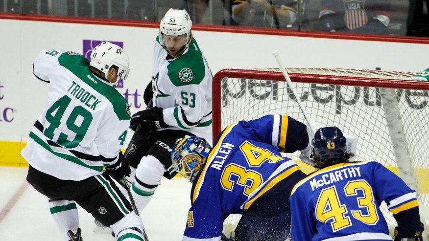 St. Louis Blues goalie Jake Allen (34) stops a shot from Dallas Stars right wing Branden Troock (49) as Stars center Justin Dowling (53) and Blues left wing John McCarthy (43) look on in the first period of a preseason NHL hockey game at the Sprint Center in Kansas City, Mo., Saturday, Sept. 27, 2014. (AP Photo/Colin E. Braley)