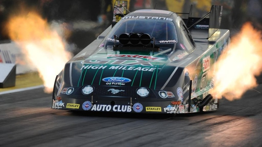 In this photo provided by the NHRA, John Force races to the provisional No. 1 qualifying spot in Funny Car at the AAA Insurance NHRA Midwest Nationals drag races at Gateway Motorsports Park on Friday, Sept. 26, 2014, in Madison, ill. (AP Photo/NHRA, Marc Gewertz)